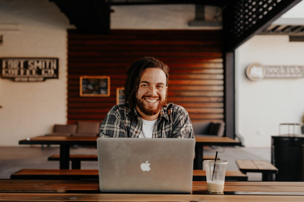 Man with his laptop smiling